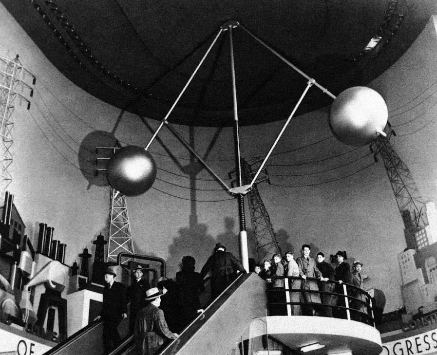 "In this May 8, 1939 photo provided by Westinghouse, vistors ascend the ""electric stairway"" in the Hall of Power at the Westinghouse Building at the World's Fair in New York. (AP Photo/Westinghouse)"