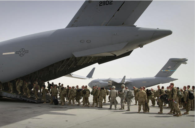 U.S. soldiers board a U.S. military plane, as they leave Afghanistan, at the U.S. base in Bagram north of Kabul, Afghanistan. The United States is not alone in pulling combat troops off the Afghan bat