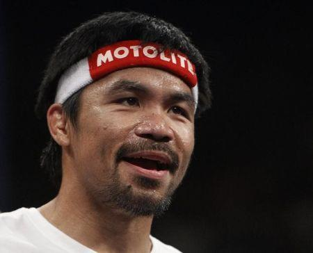 Pacquiao of the Philippines enters the ring for his WBC, WBA and WBO welterweight title unification fight against against Mayweather, Jr. of the U.S. in Las Vegas