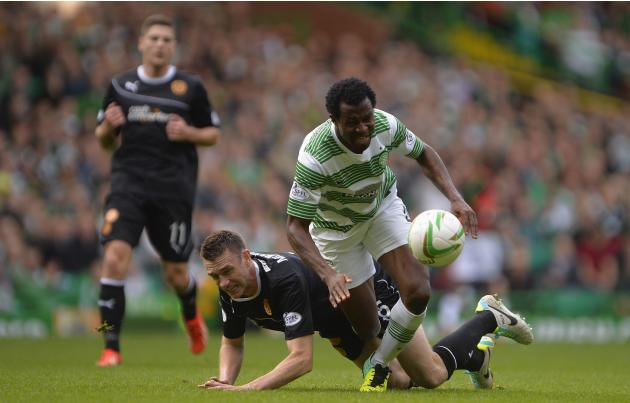 Motherwell's McManus challenges Celtic's Ambrose during their Scottish Premier League soccer match at Celtic Park