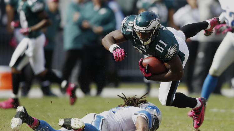 Philadelphia Eagles wide receiver Jason Avant (81) goes up after a hit by Detroit Lions free safety Louis Delmas, left, during the first half an NFL football game, Sunday, Oct. 14, 2012, in Philadelphia, Philadelphia. (AP Photo/Mel Evans)