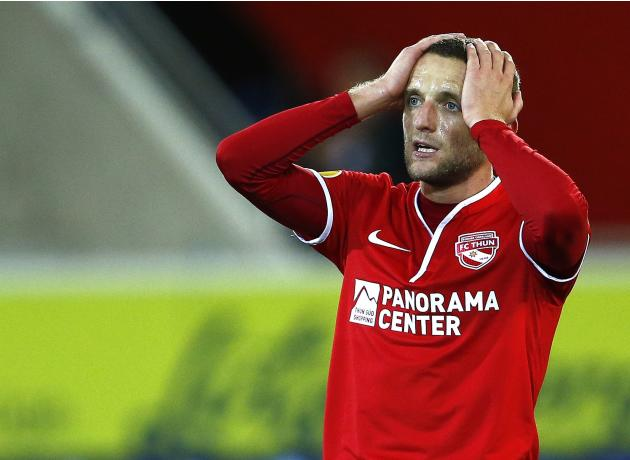 FC Thun's Schneuwly reacts after missing a goal against Rapid Wien during their Europa League soccer match at the Thun arena in Thun