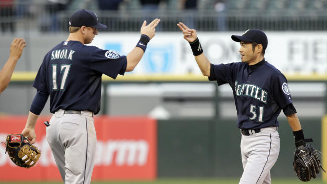Seattle Mariners' Ichiro Suzuki, right, of Japan, celebrates with Justin Smoak after they defeated the Chicago White Sox 10-8 in a baseball game in Chicago, Saturday, June 2, 2012. (AP Photo/Nam Y. Huh)