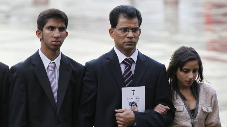 Husband of late Jacintha Saldanha, Benedict Barboza, center, son Junal, 16, and daughter Lisha, 14, arrive at Westminster Cathedral in London for a memorial service for nurse Jacintha Saldanha who took her own life after answering a hoax phone call at King Edward VII hospital where she worked, Saturday, Dec. 15, 2012. Australian radio hosts managed to impersonate Queen Elizabeth II and Prince Charles and received confidential information about the Duchess of Cambridge's medical condition, in a hoax phone call to the hospital where the pregnant Duchess was staying and which was broadcast on-air. The controversial prank took a dark twist three days later with the death of Saldanha, a 46-year-old mother of two, who was duped by the DJs despite their Australian accents.  (AP Photo/Sang Tan)
