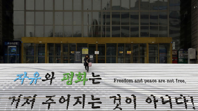 A woman walks down the stairs at the Korea War Memorial Museum in Seoul, South Korea, Tuesday, Jan. 29, 2013. North Korea appears all set to detonate an atomic device, but confirming the explosion when it takes place will be virtually impossible for outsiders, specialists said Tuesday. (AP Photo/Lee Jin-man)