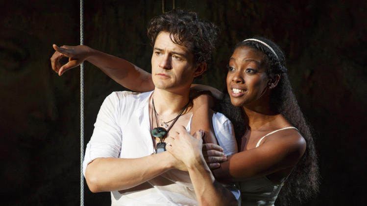 "This theater image released by The Hartman Group shows Orlando Bloom, left, and Condola Rashad during a performance of ""Romeo and Juliet,"" in New York. (AP Photo/The Hartman Group, Carol Rosegg)"