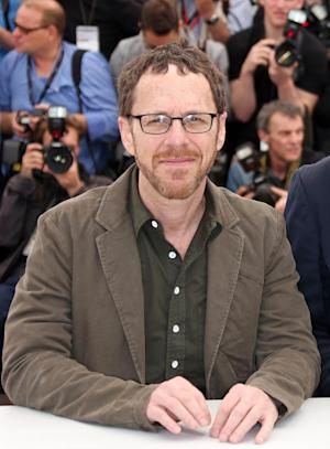 "FILE - This May 19, 2013 file photo shows film director and playwright Ethan Coen during a photo call for the film ""Inside Llewyn Davis"" at the 66th international film festival, in Cannes, southern France. The world premiere of Ethan Coen's first full-length stage play, a revival of ""The Threepenny Opera"" and a new play by Stephen Adly Guirgis will highlight the Atlantic Theater Company's upcoming season. Coen, half of the prolific filmmaking Coen brothers, offers his ""Women or Nothing,"" about two women desperate to have a child. It will be directed by David Cromer and begin performances Aug. 28.  (Photo by Joel Ryan/Invision/AP, file)"