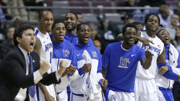 Memphis players celebrate on the bench in the first half against Saint Mary's during a second-round game of the NCAA men's college basketball tournament in Auburn Hills, Mich., Thursday March 21, 2013. (AP Photo/Paul Sancya)