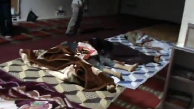 This image made from amateur video released by Shaam News Network and accessed Saturday, May 26, 2012 purports to show covered bodies after a government assault on Houla, Syria. Government troops shelled a string of villages in central Syria before pro-regime thugs swept through the area, shooting people in the streets and in their homes in attacks that killed more than 90 people, activists said Saturday. The assault on Houla, an area northwest of the central city of Homs, is one of the bloodiest single events in Syria's 15-month-old uprising. (AP Photo/Shaam News Network via AP video) TV OUT, THE ASSOCIATED PRESS CANNOT INDEPENDENTLY VERIFY THE CONTENT, DATE, LOCATION OR AUTHENTICITY OF THIS MATERIAL