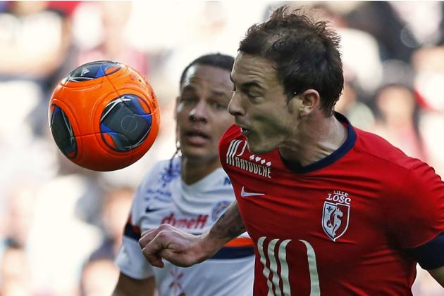 Lille's Roux fights for the ball with Montpellier's Congre during their French Ligue 1 soccer match in Villeneuve d'Ascq
