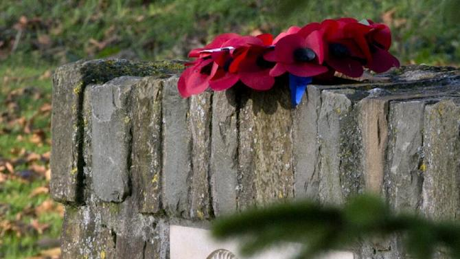 In this photo taken on Nov. 21, 2014, a red wreath of poppies is left on the top of the Christmas Truce monument in Frelinghien, France. Frelinghien was one of several sites along the then approximately 500 mile long Western Front in which fraternization was reported between opposing troops in World War I. (AP Photo/Virginia Mayo)