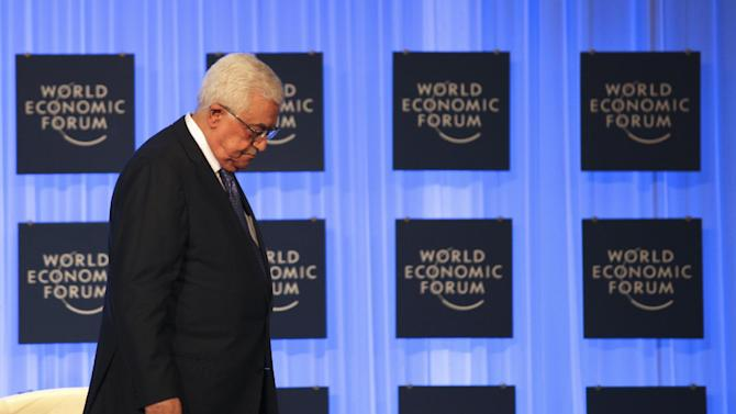 "Palestinian President Mahmoud Abbas leaves the podium after giving a speech at the World Economic Forum, in Southern Shuneh, 34 miles (55 kilometers) southeast of Amman, Jordan, Saturday, May 25, 2013. Speaking at the meeting on the shores of the Dead Sea in Jordan, Abbas appealed to Israel to ""make peace a reality.""  He told the gathering that among his top priorities are ending Palestinian divisions, Jewish settlement activity, Israel's occupation of the West Bank and freeing Palestinian prisoners from Israeli jails. (AP Photo/Mohammad Hannon)"