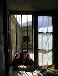 File photo shows a Afghan woman prisoner in Kabul. In Afghanistan&#39;s deeply conservative society many inmates fear they could be murdered by their families for reasons of &quot;honour&quot; after they are released from prison