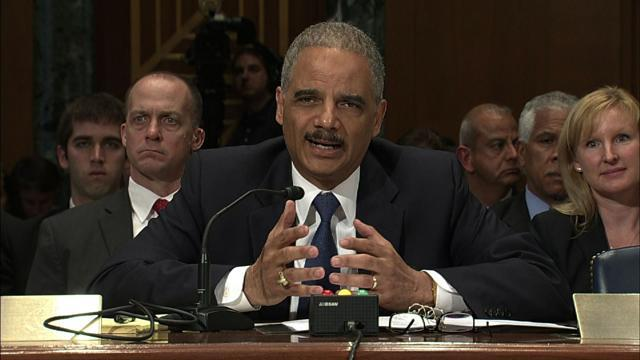 "Holder discusses the ""tipping point"" that could compel him to step down"