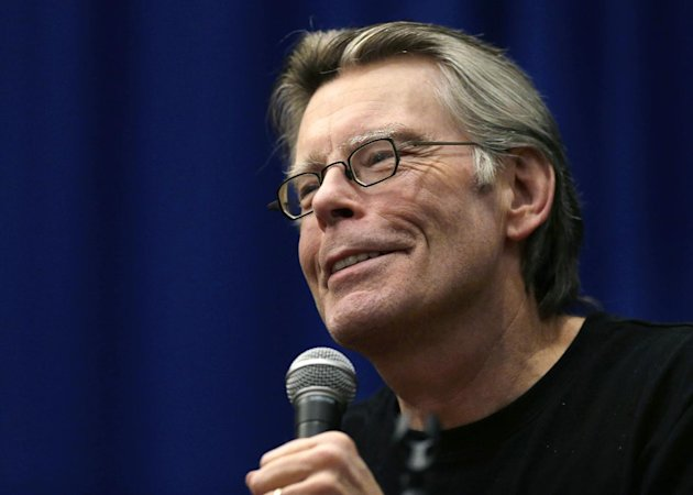 "FILE - This Dec. 7, 2012 file photo shows novelist Stephen King speaking to creative writing students at the University of Massachusetts-Lowell in Lowell, Mass. A signed copy of a rare Stephen King book is up for auction at a Maine bookstore, with proceeds going to a nearby homeless shelter's emergency home heating fund. The copy of the ""The Regulators,"" written by horror writer and Maine native King under the pen name Richard Bachman, was donated by a customer of Scottie's Bookhouse in Hancock, Maine. Owner Michael Riggs says there are only 550 copies of the book in a special collector's box. Auction proceeds will go to the Emmaus Homeless Shelter's emergency fuel fund in Ellsworth. (AP Photo/Elise Amendola, file)"
