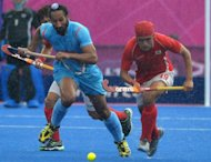 Sardar Singh of India vies for the ball with Kim Young Jin of South Korea India under a heavy shower during the men's field hockey preliminary round match during the London 2012 Olympic Games. India hockey coach Michael Nobbs has apologised for his team's embarrassing Olympic Games performance, claiming they have let down the entire nation