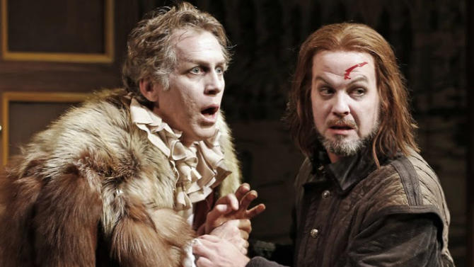 """This undated publicity photo released by David Gersten and Associates shows, from left, Stephen Spinella and Cameron Folmar, in a scene from Red Bull Theater's production of Ben Jonson's classic """"Volpone,"""" currently performing off-Broadway at the Lucille Lortel Theatre in New York.  (AP Photo/David Gersten and Associates, Carol Rosegg)"""