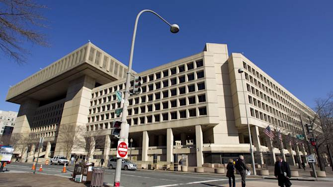 "FILE - This Feb. 3, 2012 file photo shows the Federal Bureau of Investigation (FBI) headquarters in Washington. Trying to ratchet up pressure on Congress, the White House on Friday detailed what it said would be the painful impact on the federal work force and certain government assistance programs if ""large and arbitrary"" scheduled government spending cuts are allowed to take place beginning March 1. They include layoffs or furloughs of ""hundreds of thousands"" of federal workers, from FBI agents, U.S. prosecutors and food safety inspectors to air traffic controllers, said White House budget officials at a briefing.  (AP Photo/Manuel Balce Ceneta, File)"