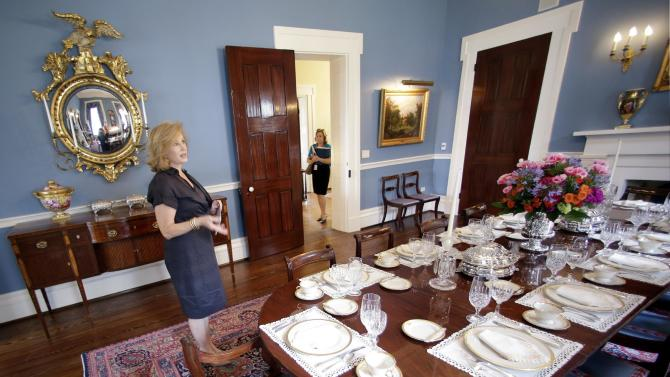 Texas first lady Anita Perry, left, shows the dinning room as she gives a tour of the recently rebuilt Texas Governor's Mansion Wednesday, July 18, 2012, in Austin, Texas. After four years and a $25 million restoration project, the historic Texas Governor's Mansion that was nearly destroyed by fire is complete. (AP Photo/Eric Gay)