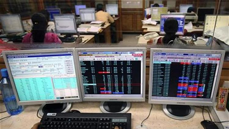 Stockbroker uses his terminal to trade at a brokerage firm in Mumbai