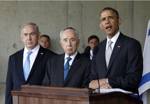 U.S. President Barack Obama speaks to the press alongside Israel's Prime Minister Benjamin Netanyahu and President Shimon Peres during his visit to the Yad Vashem Holocaust Memorial in Jerusalem