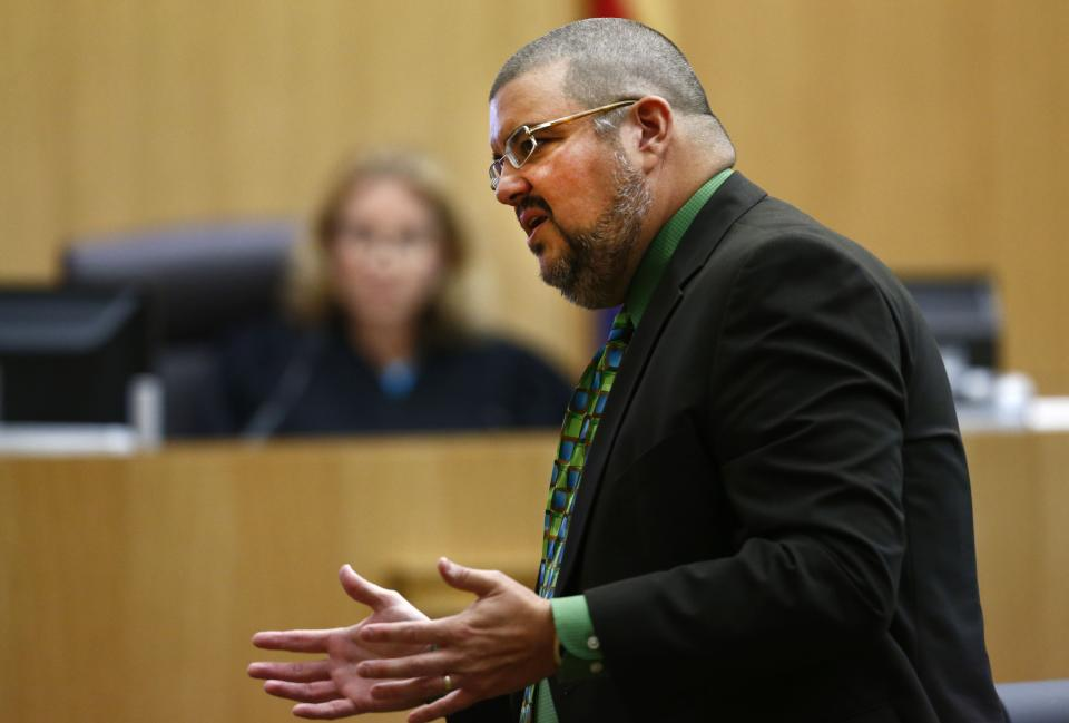 Defense attorney Kirk Nurmi addresses the jury on Wednesday, May 15, 2013 during the sentencing phase of the Jodi Arias murder trial at Maricopa County Superior Court in Phoenix. If the jury finds aggravating factors in her crime, Arias could be sentenced to death.   (AP Photo/The Arizona Republic, Rob Schumacher, Pool)
