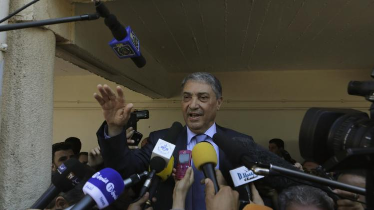 Algeria's presidential candidate and former Prime Minister Benflis speaks after casting his ballot in Algiers