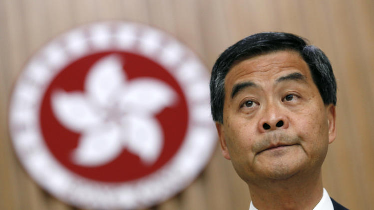 "Hong Kong Chief Executive Leung Chun-ying attends a news conference at the government headquarters in Hong Kong, Friday, Sept. 7, 2012. Leung said he is willing to have an open dialogue with opponents of national education. Protesters urged the government to cancel new additional course, ""Moral and National Education"" subject, to be introduced for school curriculum, starting from a new school year. (AP Photo/Kin Cheung)"