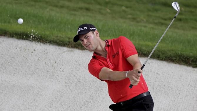 Germany's Martin Kaymer plays a bunker shot on the 8th hole during round one of DP World Golf Championship in Dubai, United Arab Emirates, Thursday Nov. 22, 2012. (AP Photo/Francois Steenkamp)