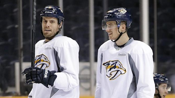 Nashville Predators defenseman Roman Josi, right, of Switzerland, talks with captain Shea Weber, left, at NHL hockey training camp on Wednesday, Jan. 16, 2013, in Nashville, Tenn. The shortened, 48-game season begins Saturday, Jan. 19. (AP Photo/Mark Humphrey)