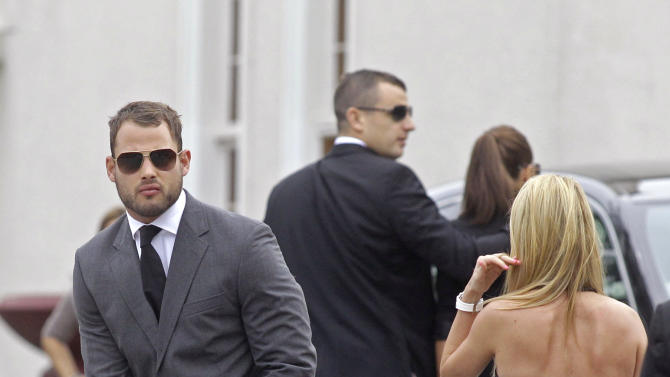 South African rugby player Francois Hougaard, left, arrives for the funeral of Reeva Steenkamp in Port Elizabeth, South Africa, Tuesday, Feb. 19, 2013. Olympic athlete Oscar Pistorius is charged with the premeditated murder of Steenkamp on Valentine's Day. The defense lawyer says it was an accidental shooting. (AP Photo/Schalk van Zuydam)