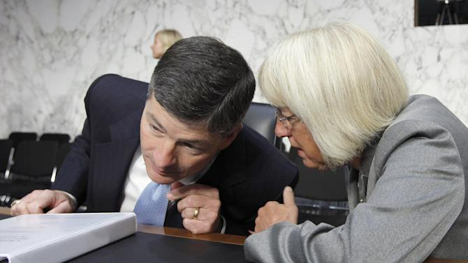 FILE - In this Sept. 13, 2011 file photo Supercommittee co-chairs Rep. Jeb Hensarling, R-Texas, left, and Sen. Patty Murray, D-Wash., right, confer as the Joint Select Committee on Deficit Reduction meets to hear testimony about the national debt from the Congressional Budget Office director on Capitol Hill in Washington. Fanning out to the sets of various talk shows Sunday, Nov. 20, 2011, Democrat and Republican Supercommittee members blamed one another other for a deepening impasse that has all but doomed any chances for accord. (AP Photo/J. Scott Applewhite, File)