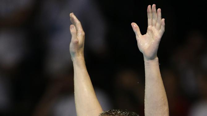 Scott Weltz celebrates after winning the men's 200-meter breaststroke final at the U.S. Olympic swimming trials on Friday, June 29, 2012, in Omaha, Neb. (AP Photo/Mark Humphrey)