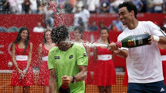 Fabio Fognini sprays David Ferrer with champagne (Reuters)