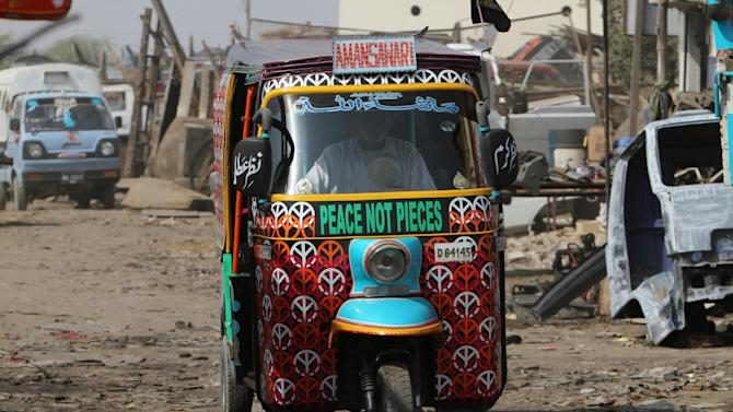 Eye-catching rickshaws promote peace in Pakistan