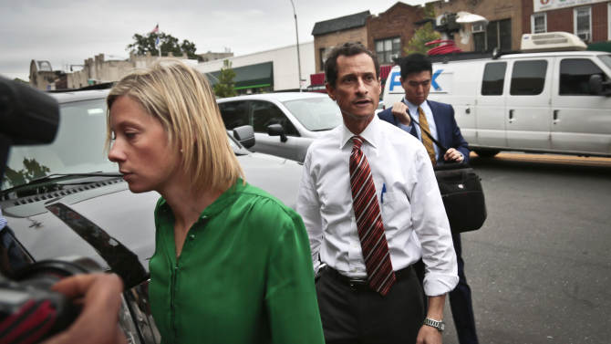 FILE - In a Thursday, July 25, 2013 file photo, New York mayoral candidate Anthony Weiner arrives with chief spokeswoman Barbara Morgan, left, at a campaign stop in New York. Morgan went on an expletive-laced tirade Tuesday, July 30, 2013 about former campaign intern Olivia Nuzzi in an interview with a political news website. Morgan later apologized for using vulgar language to describe Nuzzi and said she believed her interview with Talking Points Memo was off the record. (AP Photo/Bebeto Matthews, File)