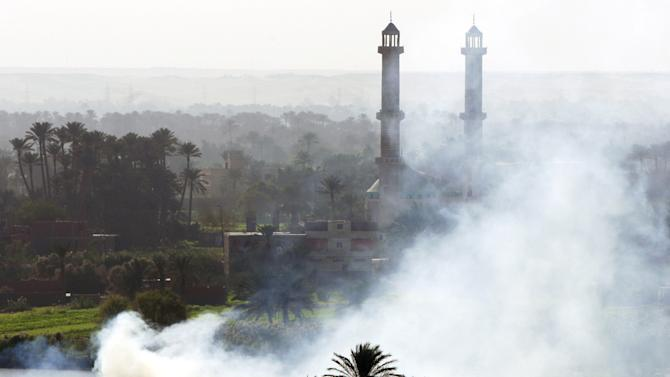 FILE - In this Tuesday, Nov. 6, 2007 file photo, smoke rises as Egyptian farmers burn their harvest remains in the village of Tamoh near Cairo, Egypt.  The Quran, Islam's holy book, is filled with more than 1,500 verses to nature and Earth. Yet the voice of Islamic leaders is missing from the global dialogue on warming. (AP Photo/Amr Nabil, File)