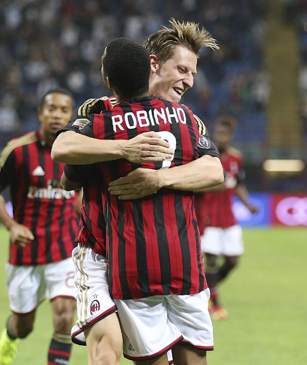 AC Milan midfielder Valter Birsa, background, of Slovenia, celebrates with his teammate  Brazilian forward Robinho after scoring during the Serie A soccer match between AC Milan and Sampdoria at the S