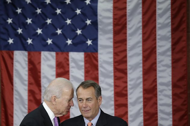 Vice President Joe Biden talks with House Speaker John Boehner of Ohio before President Barack Obama's State of the Union address during a joint session of Congress on Capitol Hill in Washington, Tues