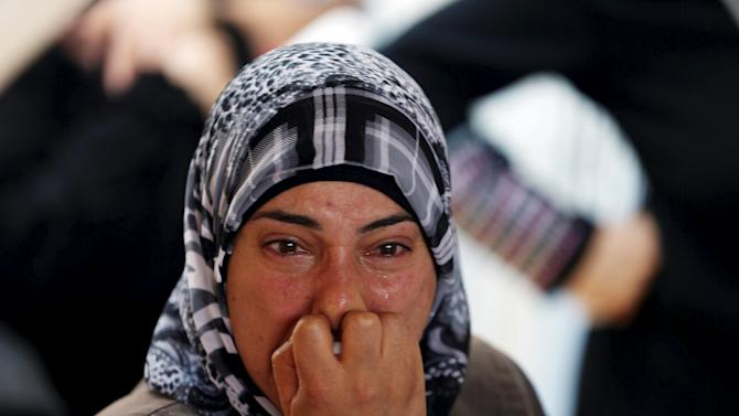 Relative of Palestinian youth Laith al-Khaldi mourns during his funeral near the West Bank city of Ramallah
