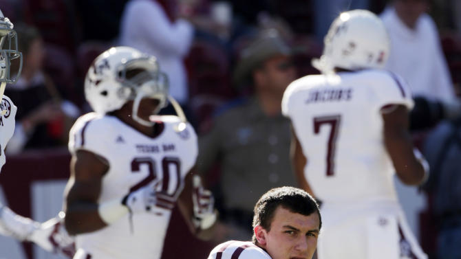 FILE - In this Nov. 10, 2012, file photo, Texas A&M quarterback Johnny Manziel (2) watches the action prior to the start of an NCAA college football game against top-ranked Alabama at Bryant-Denny Stadium in Tuscaloosa, Ala. Manziel could become the first freshman to win the Heisman Trophy when the award is presented on Saturday night. (AP Photo/Dave Martin, File)