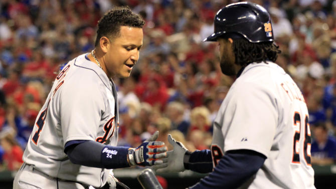 Detroit Tigers Miguel Cabrera (24) slaps hands with teammate Prince Fielder (28), after hitting his second home of the game, in the fifth inning of a baseball game against the Texas Rangers Sunday, May 19, 2013, in Arlington. (AP Photo/John F. Rhodes)