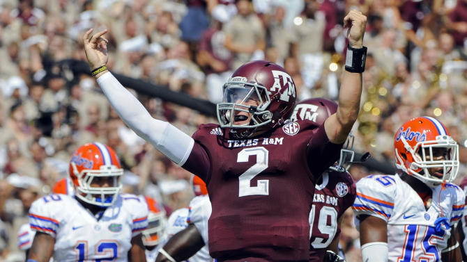 FILE - In this Sept. 8, 2012, file photo, Texas A&M's Johnny Manziel reacts after a touchdown run during the second quarter of an NCAA college football game against Florida in College Station, Texas.  Manziel could become the first freshman to win the Heisman Trophy when the award is presented on Saturday night. (AP Photo/Dave Einsel, File)