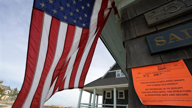"FILE - In this Jan. 3, 2013, file photo, an unsafe for human occupancy sticker is attached to a home that was severely damaged by Superstorm Sandy in Bay Head, N.J. Conservatives and watchdog groups are mounting a ""not-so-fast"" campaign against a $50.7 billion Superstorm Sandy aid package that Northeastern governors and lawmakers hope to push through the House the week of Jan. 14, 2013. Their complaint is that lots of that money actually will go toward recovery efforts for past disasters and other projects unrelated to the late-October storm. The measure bill includes $150 million for what the Commerce Department described as fisheries disasters in Alaska, Mississippi and the Northeast, and $50 million in subsidies for replanting trees on private land damaged by wildfires. (AP Photo/Mel Evans)"