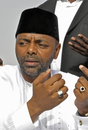 In this photo taken on Wednesday, Sept 29, 2010, Mohammed Abacha at a political meeting in Kano, Nigeria. Liechtenstein is returning $227 million looted by Nigeria's late military dictator after the Nigerian government made a deal with his eldest son to drop corruption charges against the son, the government said Thursday.With the charges dropped, supporters of Mohammed Abacha, son of the late dictator Gen. Sani Abacha, said that paves the way for him to run for governor of northern Kano state on the ticket of the ruling People's Democratic Party of President Goodluck Jonathan. (AP Photo/Sani Maikatanga)