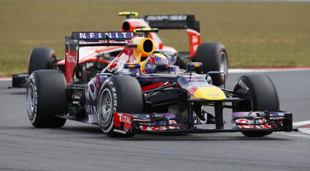 Red Bull Formula One driver Webber races ahead of Marussia Formula One driver Chilton during the qualifying session for the Korean F1 Grand Prix in Yeongam