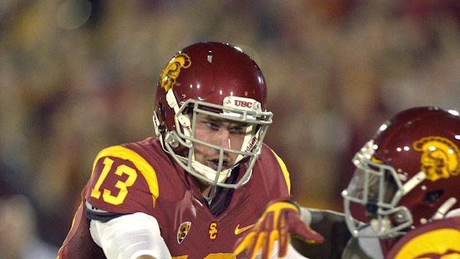 Southern California quarterback Max Wittek, left, hands off to running back Curtis McNeal during the first half of an NCAA college football game against Notre Dame, Saturday, Nov. 24, 2012, in Los Angeles. (AP Photo/Mark J. Terrill)