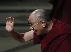 His Holiness the Dalai Lama waves good bye after his speech and at the National Cathedral in Washington