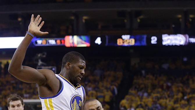 San Antonio Spurs guard Tony Parker (9), of France, drives past Golden State Warriors center Festus Ezeli (31) in the first quarter of Game 6 of a Western Conference semifinal NBA basketball playoff series in Oakland, Calif., Thursday, May 16, 2013. (AP Photo/Jeff Chiu)