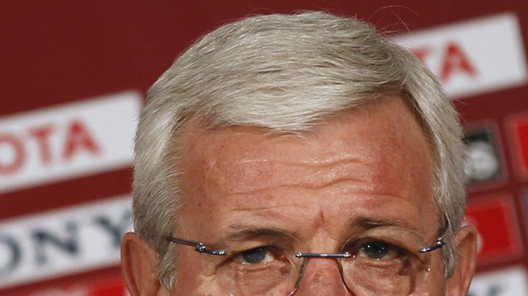 Marcello Lippi, coach of China's Guangzhou Evergrande, attends a news conference in Agadir
